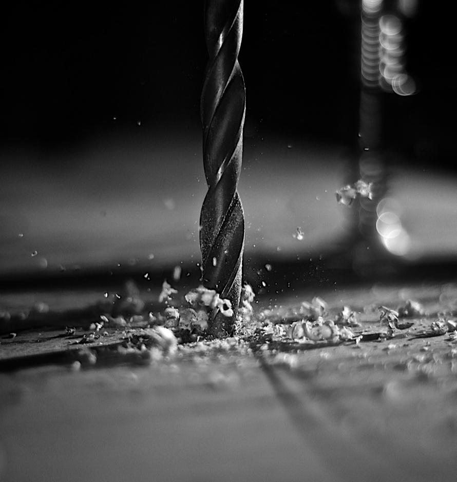 Drill bit penetrating steel