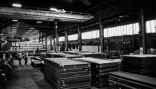 Kapital steel warehouse with stacks of steel plates